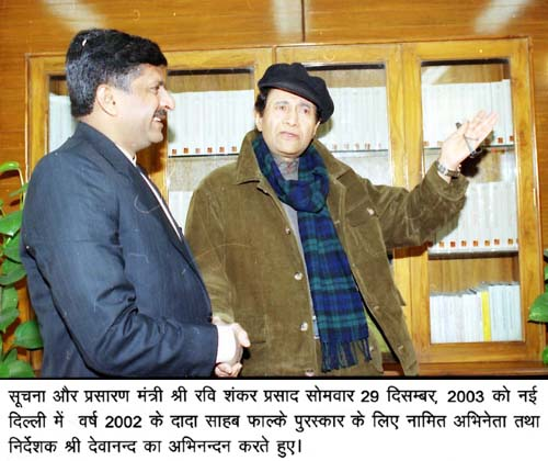 The Minister for Information and Broadcasting Shri Ravi Shankar Prasad greeting noted film Actor and Director Shri Dev Anand who has been nominated for Dada Saheb Falke Award for the year 2002 in New Delhi on December 29, 2003 (Monday).