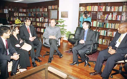 The Union Minister for Communications, IT and Disinvestment Shri Arun Shourie meets a delegation from Harvard Business School in New Delhi on December 29, 2003 (Monday)