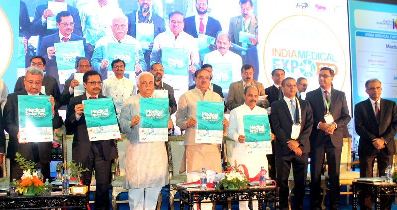 The Union Minister for Chemicals and Fertilizers, Shri Ananth Kumar releasing the booklet 'Medical Devices Park-Virtual to Reality', at the inaugural function of the India Pharma-2016 and India Medical expo-2016, in Bengaluru on January 07, 2016. The Minister for Commerce and Industries & Tourism, Karnataka, Shri R.V. Deshpande, the Minister for Medical Education, Karnataka, Dr. Sharan Prakash Patil and other dignitaries are also seen.