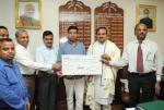 The Projects & Development India Limited (PDIL), a PSU under Department of Fertilizers, presenting a dividend cheque to the Union Minister for Chemicals and Fertilizers, Shri Ananthkumar, in New Delhi on September 03, 2014